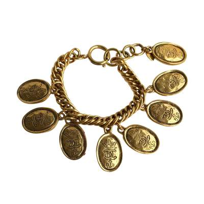 Gold metal bracelet with oval medals-0